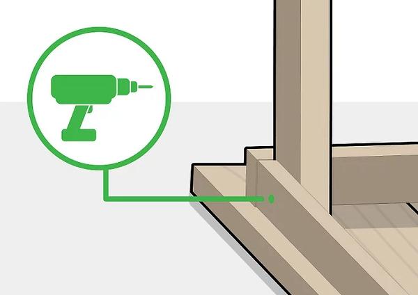 Dùng máy khoan để khoan lỗ trên khung và chân bàn