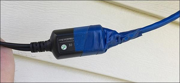 Quấn dây kết nối giữa máy quay và dây kết nối